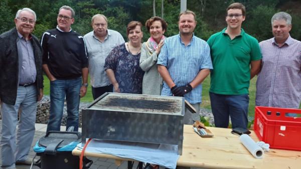 Teilnehmer am Grill